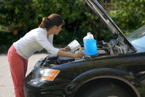 attractive woman trying to repair the car