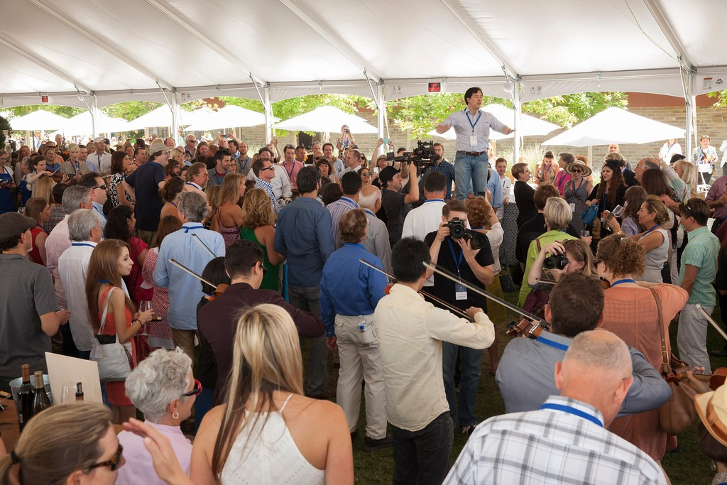 """Barrel Auction attendees were treated to a flash mob playing ""Ode to Joy"" in the main tent. Photo by Jason Tinacci"""